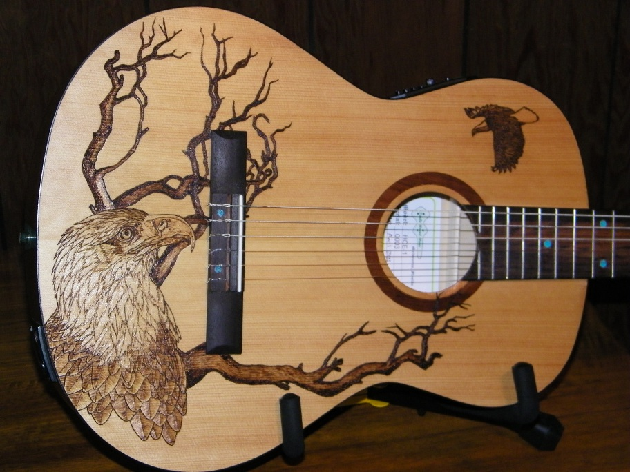 The Body Art On This Guitar Depicts A Majestic Eagle Nesting In Tree Looking Up At Another Flight These Images Are Burned Into Spruce Top Of